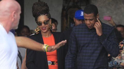 Image #: 21860910    U.S. singer Beyonce (C) and her husband rapper Jay-Z (R), are escorted by bodyguards as they leave their hotel in Havana April 4, 2013. REUTERS/Enrique De La Osa (CUBA - Tags: ENTERTAINMENT)       REUTERS /ENRIQUE DE LA OSA /LANDOV