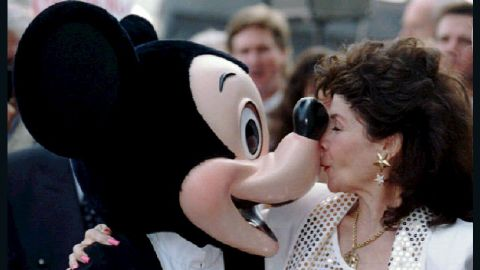 Funicello gives Mickey Mouse a kiss in 1993 after receiving a star on the Hollywood Walk of Fame.