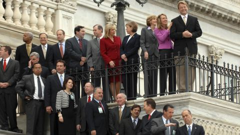 Newly elected representatives, including Giffords at second from top right, prepare for the freshman class picture for the 110th Congress on the House steps on November 14, 2006. She represented Arizona's 8th District from 2007 until her resignation in 2012.