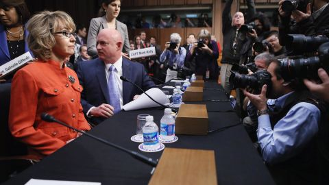 Giffords and Kelly arrive for a Senate Judiciary Committee hearing about gun control on Capitol Hill in Washington on January 30, 2013. The former congresswoman delivered an opening statement to the committee, which met for the first time since the mass shooting at a Sandy Hook Elementary School in Newtown, Connecticut.