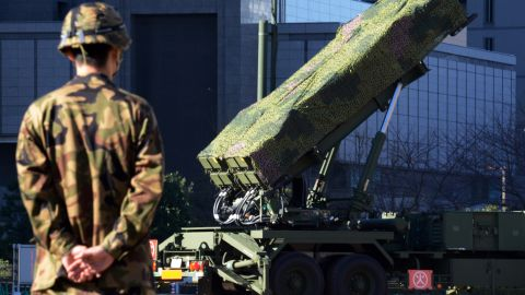 An officer of the Ground Self-Defense Force (SDF) stands guard near Japan's SDF set Patriot Advanced Capability-3 (PAC-3) missile launcher at the Defence Ministry in Tokyo on December 6, 2012. Japan on December 6 dispatched three destroyers to waters over which North Korea says its satellite-bearing rocket will travel. In Tokyo, the defence ministry has deployed another PAC-3 battery at its headquarters as part of its effort to intercept anything headed towards the Japanese mainland.
