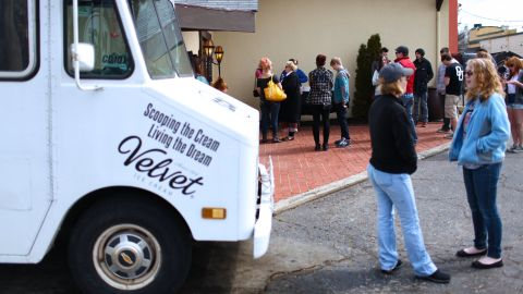 """People line up to attend one of CD102.5's <a href=""""http://cd1025.com/the-big-room"""" target=""""_blank"""" target=""""_blank"""">Big Room</a> concerts while one of the station's ice-cream trucks lingers out front. The station prides itself on being a part of the community."""