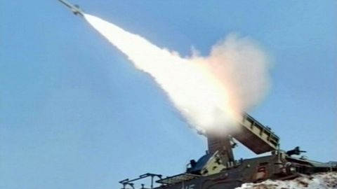 A video grab taken from North Korean TV on March 20, 2013 shows the firing of a self-propelled suface to air missile