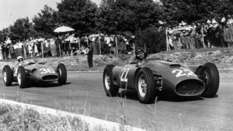 """Moss (left) trails behind Fangio at the Italian Grand Prix in 1956. """"I'm glad I raced when I did and not now because the pleasure was so much more then and the racing certainly was purer,"""" Moss says."""