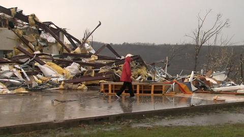 Severe weather damaged homes and businesses on Wednesday in Botkinburg, Arkansas.