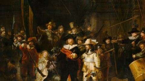 """At the heart of the gallery is its most-prized possession, """"The Night Watch,"""" by Rembrandt van Rijn (1642). The museum was designed around the painting, and it is the only artwork to be returned to its original place."""