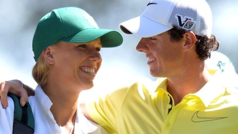 Rory McIlroy of Northern Ireland and his girlfriend tennis star Caroline Wozniacki speak as they play in the Par 3 Contest at the 77th Masters golf tournament at Augusta National Golf Club on April 10, 2013 in Augusta, Georgia. Tournament competition begins April 11. AFP PHOTO / JIM WATSON (Photo credit should read JIM WATSON/AFP/Getty Images