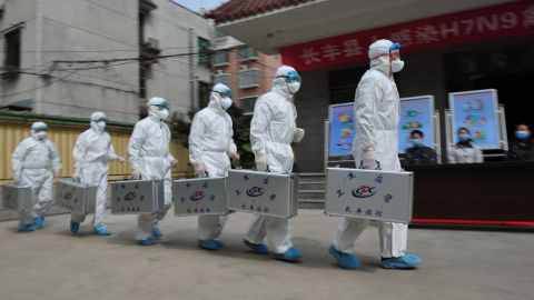 Medical workers take part in a drill that simulates human infection of the H7N9 bird flu virus on April 9 in Hefei, China.