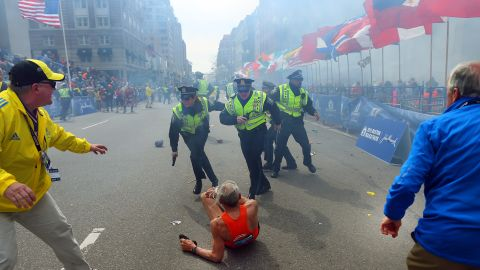 """The first explosion knocked down<a href=""""http://piersmorgan.blogs.cnn.com/2013/04/15/bill-iffrig-subject-of-iconic-boston-globe-photo-the-shock-waves-hit-my-whole-body-my-legs-just-started-jittering-around-i-knew-i-was-going-down/""""> 78-year-old runner Bill Iffrig</a> at the finish line. He got up a few minutes later and finished the race."""