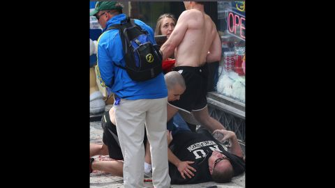 A man lies on the ground after the incident.