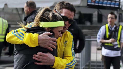 A woman is comforted after the blasts.