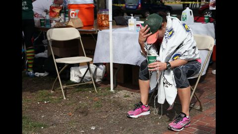 A runner sits near Kenmore Square after the attack.