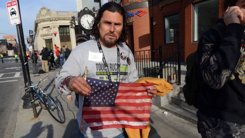 """<a href=""""http://www.cnn.com/2013/04/16/us/boston-heroes/index.html"""">Carlos Arredondo</a> was at the race handing out American flags to spectators. After the blasts, he helped emergency responders and is credited with helping a man survive serious leg wounds."""