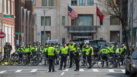 BOSTON - APRIL 15: Police officers lined Newbury Street following two explosions on Boylston Street in Boston near the finish line of the Boston Marathon. (Photo by Aram Boghosian for The Boston Globe via Getty Images)