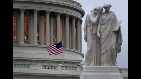 An American flag flies at half-staff at the Capitol building in Washington on April 15, 2013.