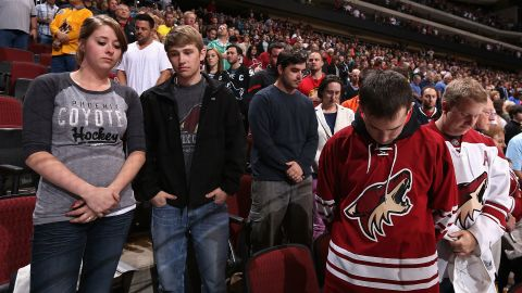 Hockey fans in Glendale, Arizona, pause for a moment of silence before a game on April 15, 2013.