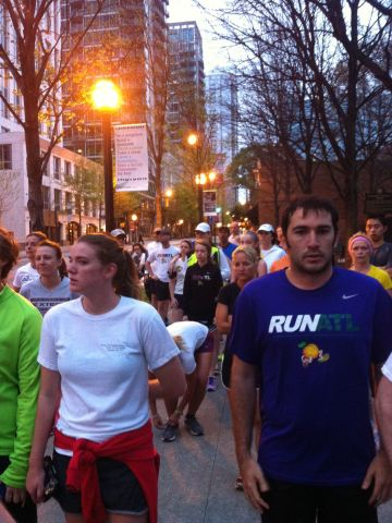 """<a href=""""http://ireport.cnn.com/docs/DOC-957408"""">CNN staff member Emily Smith</a> photographed Atlanta runners Tuesday morning running a silent mile in memory of those killed and injured in Monday's Boston Marathon blasts. """"It was an emotional morning, with many runners wearing Boston sports teams logos,"""" she says."""