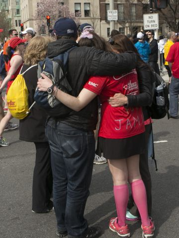 """<a href=""""http://ireport.cnn.com/docs/DOC-957434"""">Andrea Catalano</a>, a freelance photographer, shot this photo about a mile from the Boston Marathon finish line. He wanted to capture the outpouring of support from spectators and people in the area, comforting and assisting runners."""