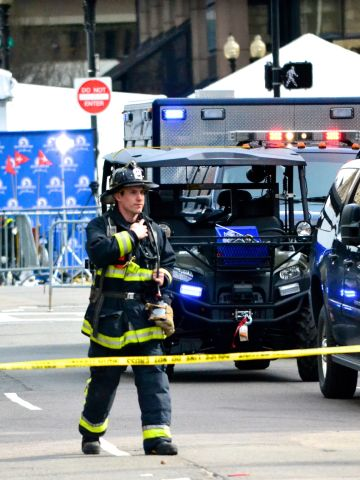 """<a href=""""http://ireport.cnn.com/docs/DOC-957445"""">iReporter Charlie Abrahams</a>, 47, had been shooting photos at mile 11 of the race when he headed back toward Boston and was greeted by sirens. He went over to Copley Square, close to where he lives, and captured photos of the first responders."""