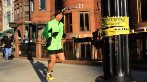 A man jogs down a street near the scene of the bombings on April 16.