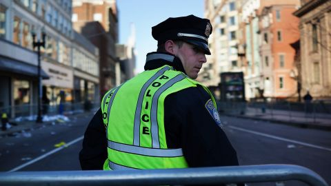 A  police officer stands on duty in Boston on April 16.