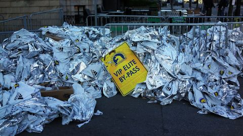Unused thermal blankets for runners are piled high near the scene of the bombings on April 16.