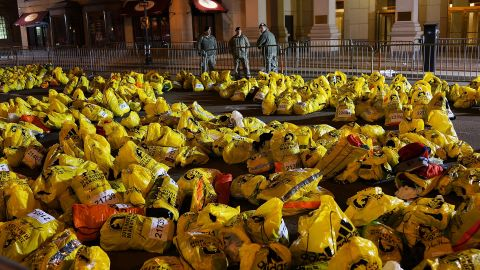 Unclaimed finish line bags litter the ground near the bombing sites. A day after the terror attack, authorities warned city residents to keep their guard up amid a massive investigation into the bombings.