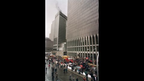 NEW YORK, NY - FEBRUARY 26:  Firefighters and rescue crews work outside the World Trade Center after smoke swept through the 110-story building after the ceiling of a train station collapsed 26 February 1993. The explosion set off a fire below the twin towers.   (FILM) AFP PHOTO MARIA BASTONE  (Photo credit should read MARIA BASTONE/AFP/Getty Images)