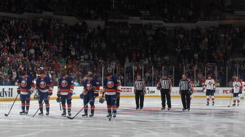 The New York Islanders and Florida Panthers stand for a moment of silence before an NHL hocky game in Uniondale, New York, on April 16, 2013.