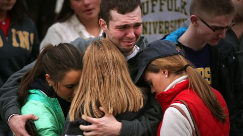 Mourners in Boston hug one another during a vigil for victims on April 16, 2013.
