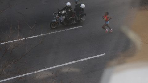 Kenyan runner Rita Jeptoo, who finished first in the women's race, makes her way toward the finish line.