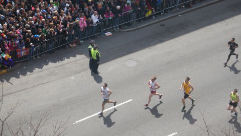 Runners pass by.