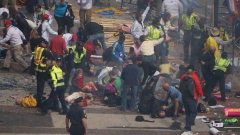 Injured people lie on the ground.