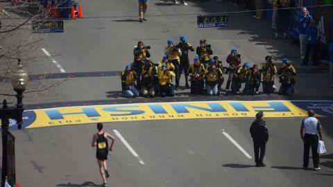 A herd of photographers captures the big race.