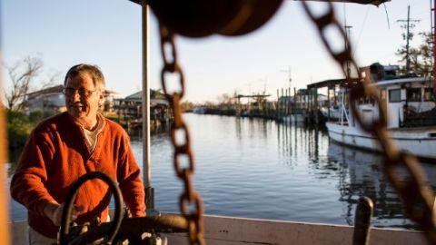 George Barisich pilots his oyster boat on Bayou Yscloskey, in St. Bernard Parish, Louisiana.