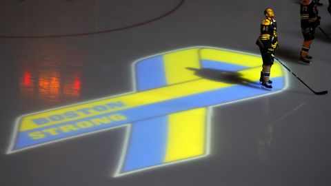 Dennis Seidenberg of the Boston Bruins observes a moment of silence before the start of an NHL hockey game in Boston on April 17, 2013. It was the first sporting event held in the city after the bombings.