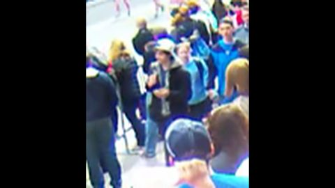 """Suspect 2 walks through the crowd. <a href=""""http://www.cnn.com/SPECIALS/us/boston-bombings-galleries/index.html"""">See all photography related to the Boston bombings.</a>"""