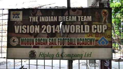 An old, torn poster hangs on a fence at the Mohun Bagan club grounds, dreaming of qualification of the national team in the 2014 FIFA World Cup. India has yet to qualify for the tournament, but hopes present developments will ensure its future presence.
