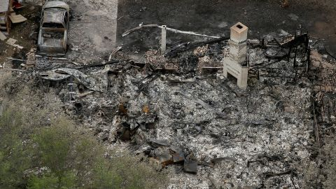 A chimney is the only part of a home left standing after the explosion.