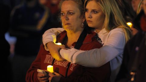 Two women embrace during a candlelight vigil in Somerville, Massachusetts, on April 18, 2013.