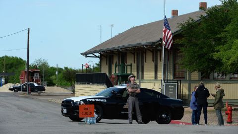 A Texas State Trooper stops people from entering a neighborhood near the plant.