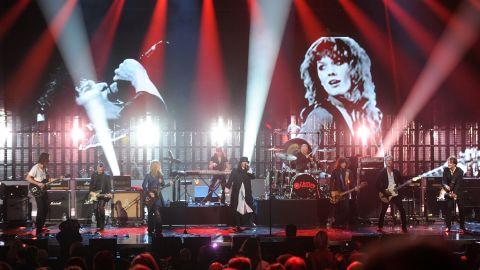 Chris Cornell and Mike McCready of Pearl Jam perform alongside Heart.