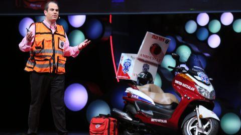 """Israeli medic Eli Beer speaks at TEDMED alongside his """"ambu-cycle."""" Beer founded an all-volunteer rescue service."""