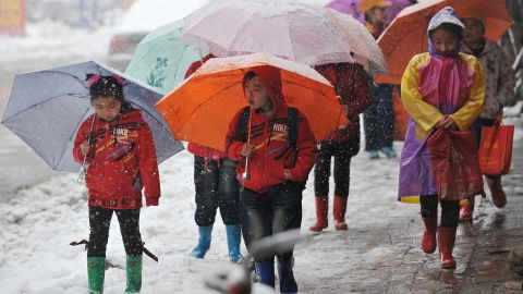 Children still feel the bite of winter weather in Taiyuan, the capital of north China's Shanxi Province, on April 19.