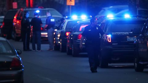 Police converge near the scene where it is believed the19-year-old bombing suspect is in hiding on April 19, 2013 in Watertown, Massachusetts.