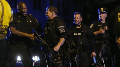 Police officers and SWAT team members celebrate after the successful operation to capture 19-year-old bombing suspect Dzhokhar A. Tsarnaev on April 19 in Watertown, Massachusetts.