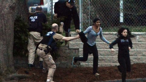 Residents flee from an area where a suspect was hiding on Franklin Street on April 19.