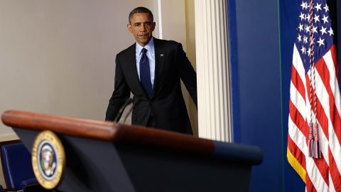"""President Barack Obama arrives in the White House briefing room to make a statement late April 19 about the capture of Dzhokhar Tsarnaev. """"We've closed an important chapter in this tragedy,"""" he said."""