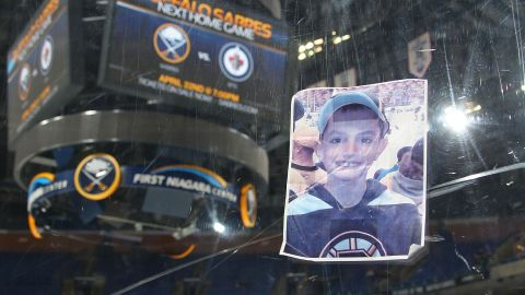 A photograph of Martin Richard, one of the victims of the Boston Marathon bombing, was placed on the plexiglass by a fan following the hockey game between the Buffalo Sabres and the New York Rangers on April 19 at the First Niagara Center in Buffalo, New York.