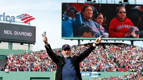 """Neil Diamond sings """"Sweet Caroline,"""" a song traditionally played at Boston Red Sox home games, during a game against the Kansas City Royals on April 20."""